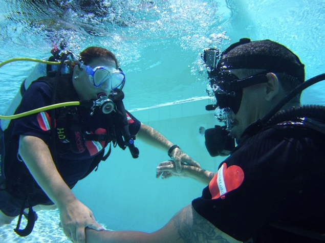 Scuba Divers taking each others hands